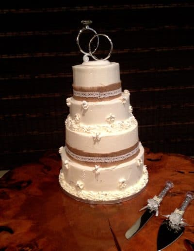filo-pastries-wedding-cake-pattern-ribbons-white-cream-frosting-mini-flowers-silver-hoops