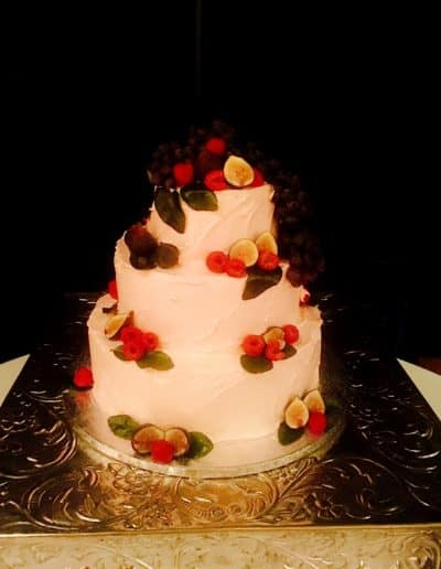 filos-pastries-wedding-cake-white-cream-frosting-berries-kiwi