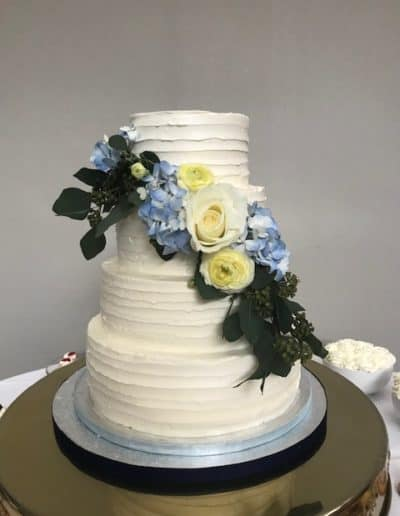filo-pastries-wedding-cake-white-butter-cream-frosting-flowers